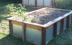 corrugated steel, raised bed gardening, modern architecture, wood