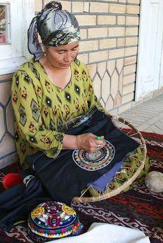 uzbek hat embroideries, craftsman from Urgut, near Samarkand city, Uzbekistan: