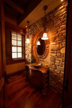 Love the idea of the natural stone in the bathroom! Would be great in a country/log home!
