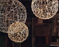 Fantastical spheres are woven from shiny nickel-plated wire and wrapped with strands of silver wire LED lights. Group the three sizes of spheres over a dining table for sublime mood lighting at any fe