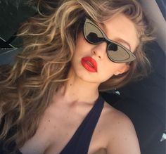Red lips and big waves.