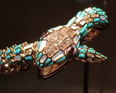 Bulgari Serpenti bracelet with mother of pearl and turqouise scales and diamond details.