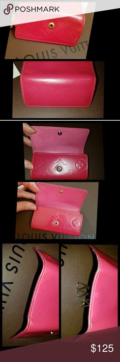 "Louis Vuitton multi cles 4 ~Patent Leather in gorgeous framboise (pink) ~Date code CA1005 ~Made in Spain October 2005 ~Size Approx 4.1""×2.2""  The outside vernis shows no signs of color transfer.*FLAWS*The edges are somewhat distressed as shown in the photos. The inside left above the snap on the very top has a few centimeters of distressment on the leather shown in photos.Tiny blip in vernis on outside pic #2.The brass four ring key holder does have a few areas of tarnish.Snap is tight. Pics…"