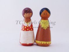 prairie girl and american indian girl peg people