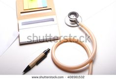 Stethoscope , notebook and pen on desk in top view.