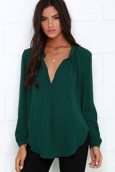 When you're in need of a little pick-me-up, add the That Certain Something Dark Green Top into the mix for the perfect amount of perk! Lightweight woven poly plunges into a deep V-neckline framed by long sleeves, while the billowing straight-cut bodice finishes in a chic rounded hemline. Unlined. 100% Polyester. Hand Wash Cold.