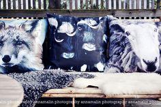 Helt Enkelt    animal photographs on pillows.