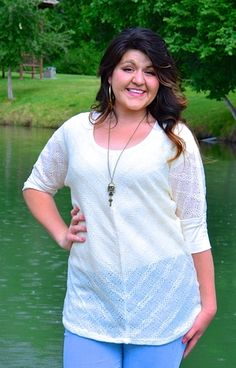 Ivory knit tunic over light jeans with long necklace
