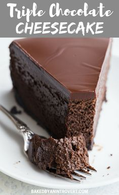 Triple Chocolate Cheesecake with an Oreo crust and a rich chocolate glaze is a decadent dessert that is ultra creamy and smooth. #bakedbyanintrovertrecipes #chocolate #cheesecake