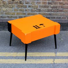 Small coffee table made of an art crate used to transport a work on paper to London's East End.Materials: birch and pine wood Colours: satin electric orange combined with high gloss black paintProduct dimensions:Length: 27 inches (68.5 cm) Depth: 22 3/4 inches (57 cm) Height: 19 inches (48 cm)Shipping info: due to the size and weight of this item we can offer delivery to Mainland UK, Austria, Belgium, Czech Republic, Denmark, France, Germany, Italy, Netherlands, ...