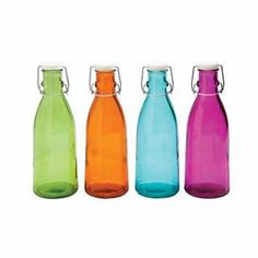 "Colored bottle crafted from recycled glass.  Product: Set of 4 bottlesConstruction Material: GlassColor: Green, orange, blue and fuchsiaDimensions: 11.02"" H x 3.94"" Diameter"