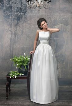 This Simply Chic Antares Wedding dress made from Mikado. The belt are decorated with small elegant beads and crystals Fully lined. The bride with