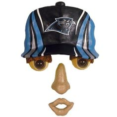 """16.5"""" NFL Carolina Panthers Fan Memorabilia Outdoor Tree Forest Face by Evergreen. $29.99. Carolina Panthers Forest Tree FaceItem #0083824OFFICIALLY LICENSED MERCHANDISEBring your trees to life with this forest face decorationTree face features an eye popping expression wearing an official Carolina Panthers capDimensions: 16.5""""L x 11""""W x 2.8""""HMaterial(s): synthetic"""