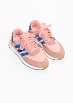 & Other Stories image 2 of adidas Iniki in Haze Coral/Blue