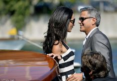 Look into my eyes: Glowing couple George Clooney and Amal Alamuddin couldn't take their eyes off each other when they sped through Venice, Italy, on Friday on taxi boats to their future wedding location