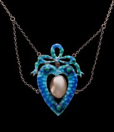 This is not contemporary - image from a gallery of vintage and/or antique objects. ARTS & CRAFTS  Love Token Pendant  Silver Enamel Pearl Ruby