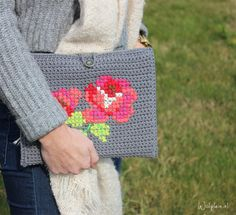 Here's an amazing crochet and cross-stitch iPad cover from WolPlein.Nl. Google Translate does a good job with the pattern, so it'...