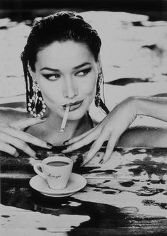Espresso, a cigarette, diamonds, and water...Nice combo. Carla Bruni. Lavazza 1995 Calendar - Ellen Von Unwerth