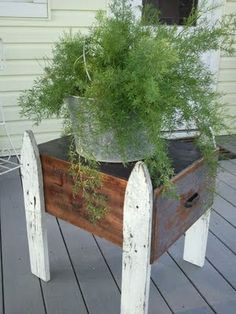 Plant stand, old wooden box and fence posts.