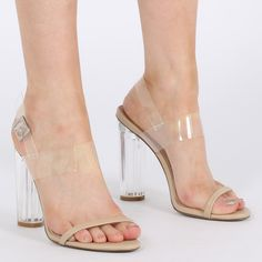 We know what the destiny of these killer heels will be...straight onto your feet. Featuring clear perspex straps with a thin faux leather toe strap. The transparent heel gives the queens jewels a run for their money. We're thinking all over metallic with these shoesies. Go for a pleated silver midi skirt and a strappy cami to complete the look.  Heel Height: 4.1\