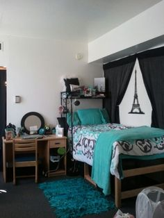 Blue-green and black make for a modern and very interesting but relaxing college dorm room color scheme