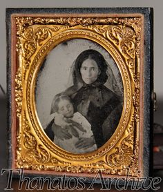 c1860s Post Mortem Ambrotype Photo // Mother in Black Holding Dead Child. $185.00, via Etsy.