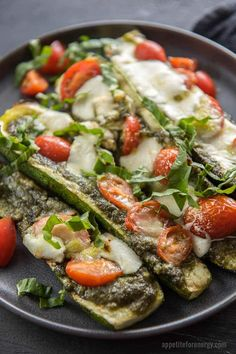 Grilled Caprese Stuffed Zucchini Boats are an easy, cheesy, healthy summer appetizer. Great for summer backyard parties and barbecues. If you love pizza, you'll love this recipe! Side Dish Recipes, Lunch Recipes, Vegetarian Recipes, Dinner Recipes, Healthy Recipes, Vegetarian Diets, Keto Recipes, Side Dishes, Vegetarian Lunch
