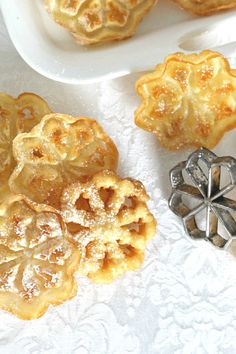 Easy recipe for Scandinavian Rosettes. Thin, cookie-like, deep-fried pastry treats are light and crispy. Perfect on your holiday cookie tray. Rosettes Cookie Recipe, Rosette Recipe, Rosette Cookies, Xmas Food, Christmas Baking, Christmas Foods, Christmas Treats, Scandinavian Rosettes Recipe, Appetizer Recipes