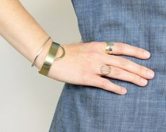 Ela Cuff Bracelet | The shine and elegant use of negative space on the Ela cuff will have you all heart-eyed every time you glance down at your wrist. Pair with the Nisi cuff in either brass or sliver plated for a truly harmonious accessory moment. Materials: brass or silver plated original b&i modern shape from hand formed thick sheet metal. Made by hand in our Portland, Oregon studio.