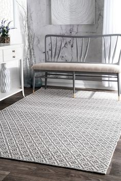Bring in a relaxed look to your interiors with this flat woven, geometric patterned rug that is hand loomed with 100% cotton. This attractive rug comes in different colors and sizes to suit your décor and can easily go under your furniture without a trouble.