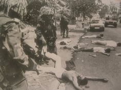 American soldiers with dead Panamanian civilians; US Invasion of Panama, 1989.