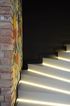 Lights for stairways are as crucial as the lighting of any rooms in your house. A good lighting for the stairs should not be underestimated. The dark stairways might cause a . Staircase Lighting Ideas, Stairway Lighting, White Ceiling, White Walls, White Glossy Kitchen, Colorful Apartment, Stair Steps, Old Bricks, Basement Stairs