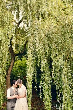 A shared moment in the willows at @Lucy Kemp Kemp Pray's @Willow Buscemi Weir Lodge wedding