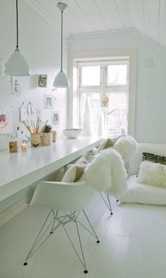 long white desk. simple pendants and chairs.