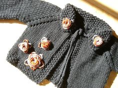 Bee-u-ti-ful Knitted Baby Sweater: free pattern on Ravelry  http://www.ravelry.com/patterns/library/pretty-in-pink-knit-jacket-and-booties
