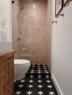 An incredible installation using Our handmade Zellige and Cement tiles. used our Blush Zellige tiles on the shower wall and Superstar Black cement tiles on the floors. Hall Closet, Closet Bedroom, Stock Tank Pool, Shower Routine, Black And White Tiles, Concrete Tiles, Delta Faucets, Bathroom Inspiration, Bathroom Ideas