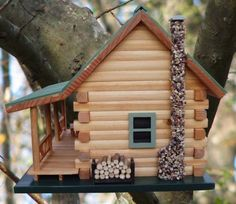 """The Wyoming birdhouse resembles a real log cabin, much like the one I imagine retiring to when I get old. Pine logs are """"milled"""" in our shop and the all-wood roof mimics that of an authentic metal roof found on many log structures. We used 95% recycled materials to build this beautiful log home for birds. Cabin measures 13-1\/3w x 11d x 10-1\/4t (from base) and has a 1-1\/4"""" hole which attracts birds such as; Titmouse, Nuthatch and Downy Woodpecker. It has a stone fireplace and miniature…"""