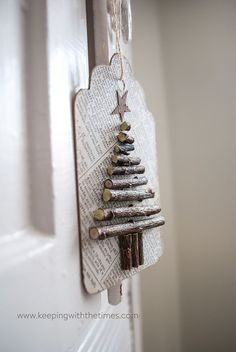 Use old paper, dried twigs, and a bit of ink, to create these cute recycled paper twiggy tags! Great for hanging on the Christmas tree or using for tags.