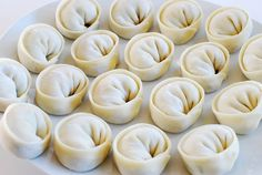 Mandu.  And aren't these beautiful?  Easy veratile Korean Mandu.  I can think of no better recipe to start with.  Plus I love Rasa Malaysia.