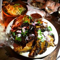Smoking Goat in Soho. Thai style BBQ. Expensive, but the pork belly and the aubergine were mouth-wateringly awesome. No reservations, and busy.