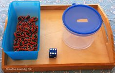 in hand manipulation - dice counting with erasers and putting in task from Creative Learning Fun