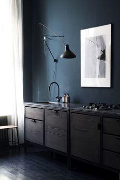 Love the black wood floor against the dark walls.