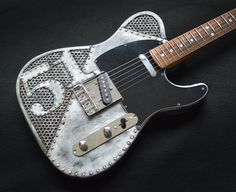 The guitars in this gallery are sold, but will give you an idea of what can be done. Occasionally in-stock guitars for sale will be featured and noted as available.