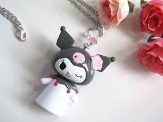 Kawaii Summer Style Winking Kuromi with hibiscus flower Necklace. $35.00, via Etsy.