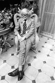 between his glasses and his chair, there's a bit of Devil feel here  - David Hockney by Cecil Beaton.