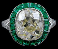 Diamond Emerald Ring.  The center diamond is an old mine cut diamond that is approximately 5.09cts.
