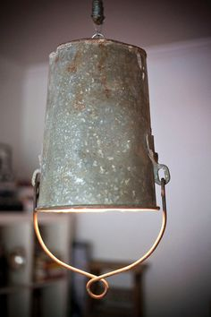 An old bucket and a little overhead wiring equals vintage lighting at its finest. I have this same bucket. Found it in our woods. Lamp Light, Light Up, Bucket Light, Deco Luminaire, Deco Table, Vintage Lighting, Lamp Shades, Rustic Furniture, Rustic Decor