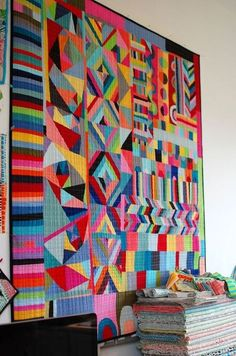 Totally stunning solids scrap quilt. (Anyone know the original artist/source?)