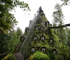 """The volcano hotel-southern Chile!  once-a-day volcano """"eruption,"""" which will send cascades of water down its walls and down the windows of the hotel rooms"""