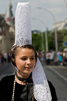 The Bigouden area (part of the French Brittany - Bretagne) is located at the west side of Quimper, and starts from a city named Sainte Marine on the bank of the Odet river. Traditional headdress (height 35 cm).
